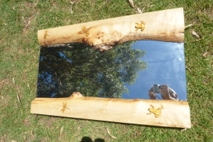 Carved mirror frame with frogs and dragon flies