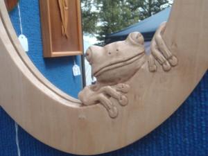 Frog carving in frame